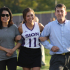 Varsity Captain Zoey Sweeny is honored during senior night, before the game against St. Thomas Aquinas.