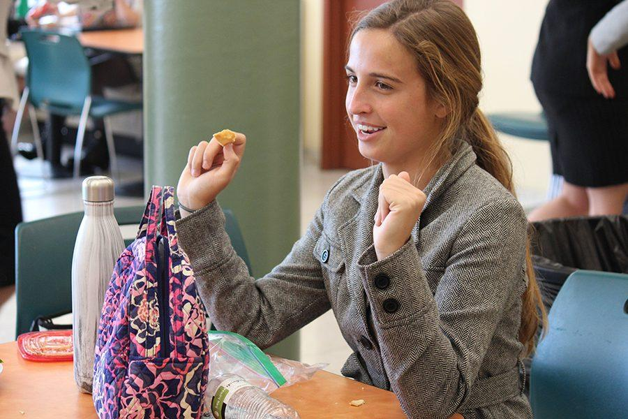 Junior Mandy Mayer enjoys her lunch while wearing her business clothing.