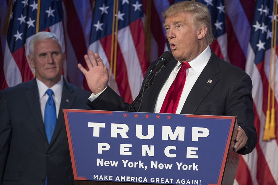 President-elect Donald Trump, joined on stage by running mate Mike Pence, speaks to supporters at the Election Night Party at the Hilton Midtown Hotel in New York City on Nov. 9.