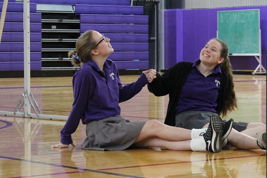 Sisters senior Grace Prusa and sophomore Tess Prusa were chosen as volunteers to represent the chemicals inside one's brain.