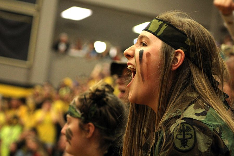 Scream Team leader senior Maddie Marquardt keeps spirits high and leads the crowd in a chant.