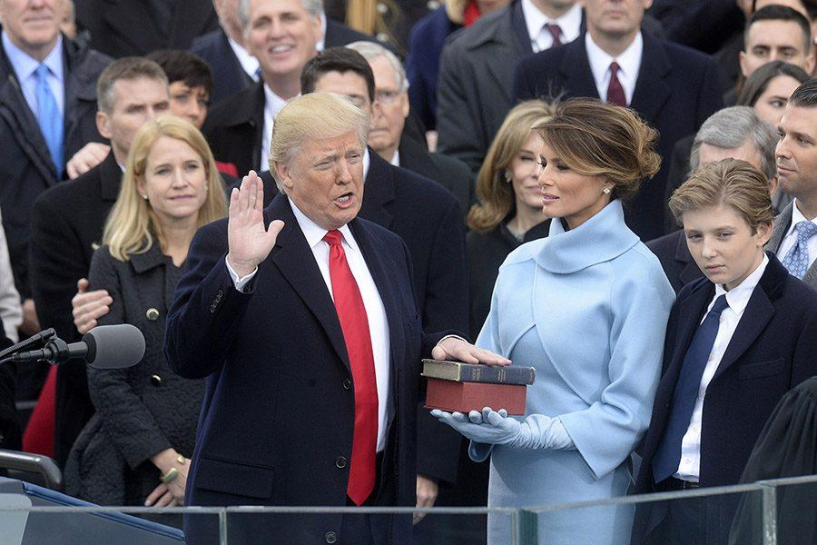 Chief Justice of the United States John G. Roberts, Jr. administers the oath of office to President Donald Trump during the 58th Presidential Inauguration Jan. 20, 2017.