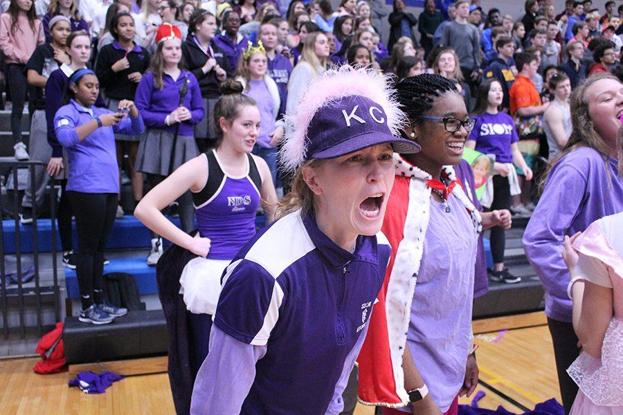 Athletic Director Kate Pilgreen, who acted as the team coach, cheers on the team while playing St. Teresa's Academy.