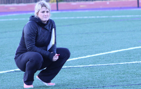 Varsity Lacrosse Head Coach Molly Crawford watches as players participate in tryouts.