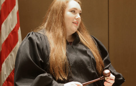While serving at Kansas City Youth Volunteer Court Feb. 21, Mackenzie Hutcheson awaits courtroom proceedings.