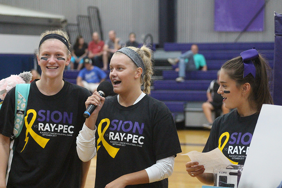 "Seniors Ella Anstoetter, Allie Weinrich and Lauren Ismert present their senior service project ""Bags of Fun KC"" before the volleyball game Sept. 20."