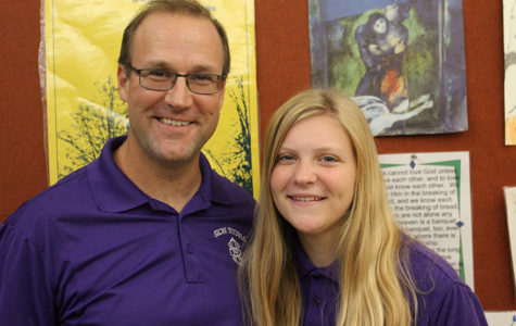 Theology teacher Paul Kramschuster and his daughter, freshman Sharon Kramschuster pose for a picture.