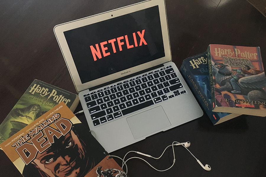 With a Walking Dead comic thrown in among Harry Potter books, senior Anna Tomka is conflicted as she watches Netlfix.
