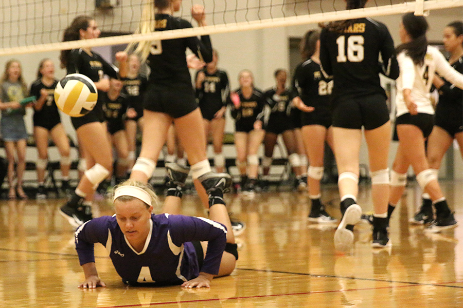 Senior Allie Weinrich gets off the floor after diving for a ball during the second match Sept. 13.