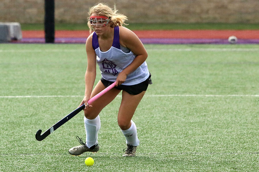 During the annual Purple vs White scrimmage on August 29, Freshman Hannah McGraw dribbles up the field for the white team.