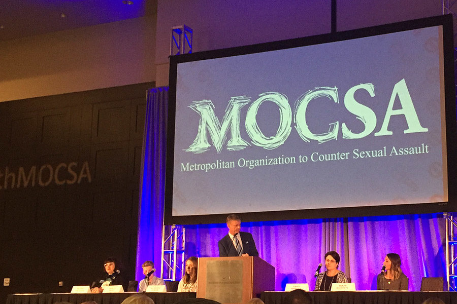 Event Master of Ceremonies John Holt leads a panel discussion with two local teachers, two students and a MOCSA preventions specialist about educating students about sexual assault prevention and awareness.