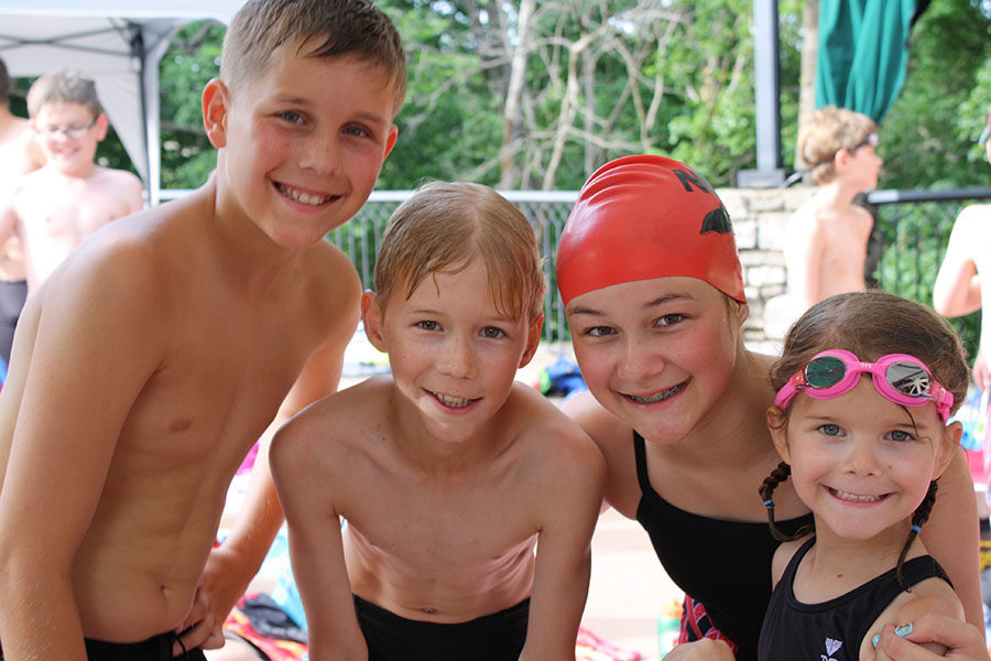 Grojean poses for a picture with siblings Dylan Grojean, Tyler Grojean and Ava Grojean during a swim meet this summer.
