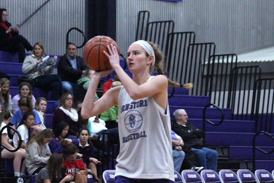 Senior Maddie Young prepares to shoot the basketball in warmups before the scrimmage Nov. 10.