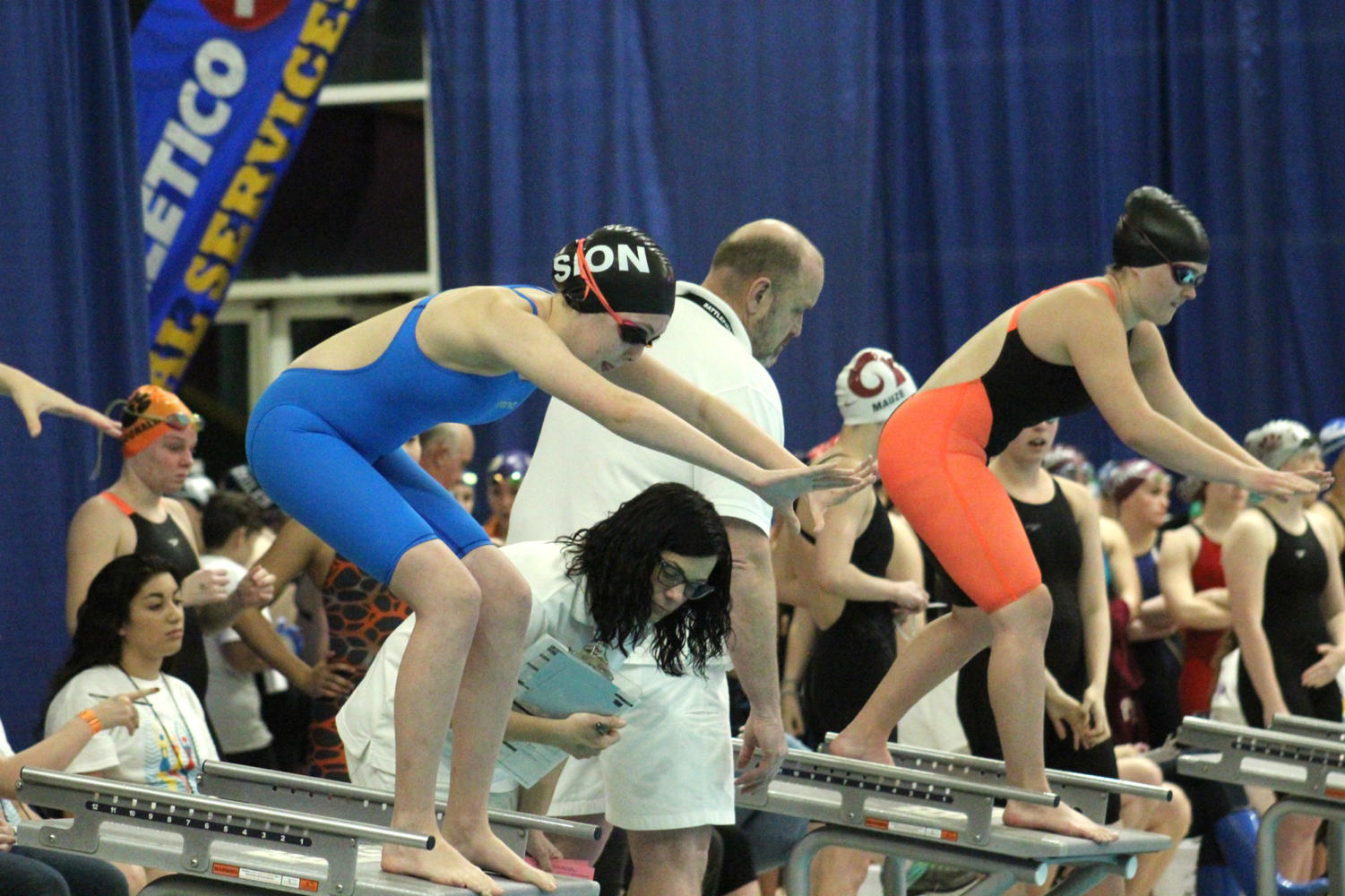 During the State competition Feb. 17, 2017, sophomore Bridget Schumm is ready to take dive off the starting block to swim in a team relay.