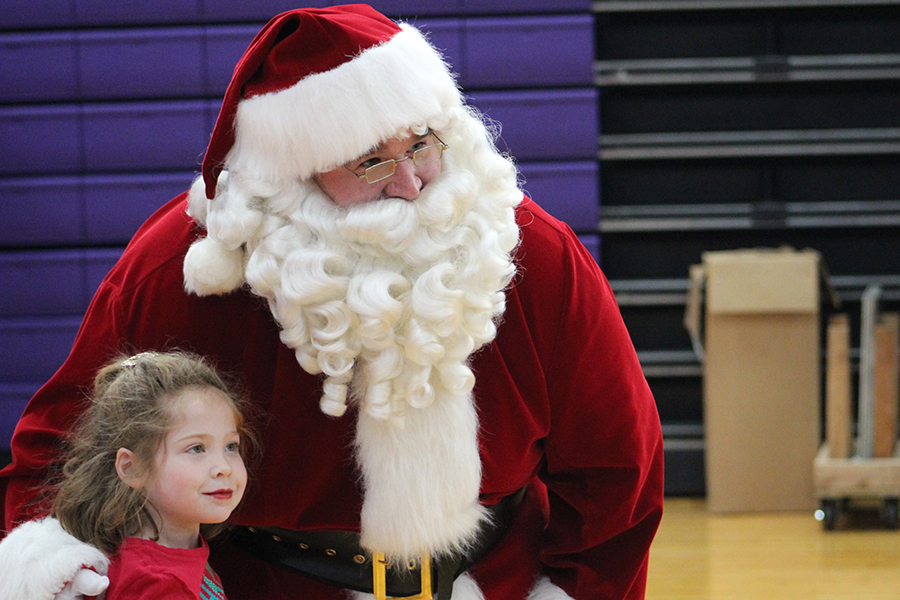 Director of Facilities and Operations Andy Sheer poses with a girl from the lower school at the annual Breakfast With Santa Dec. 2.