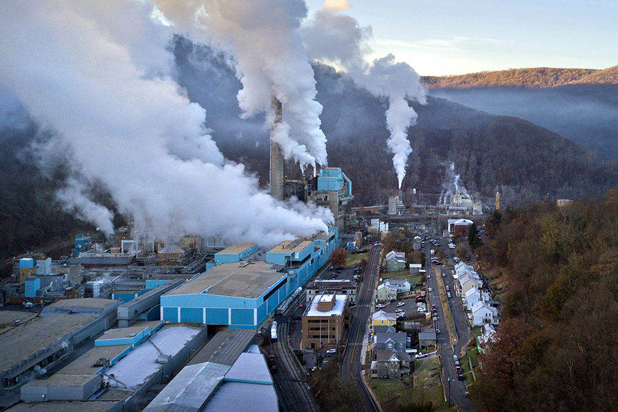 "The 228-acre Verso paper mill dwarfs the town of Luke on the banks of the Potomac River in Western Maryland, on Nov. 21. The plant generates much of its own power by burning ""black liquor,"" a sludge byproduct of the paper making process."