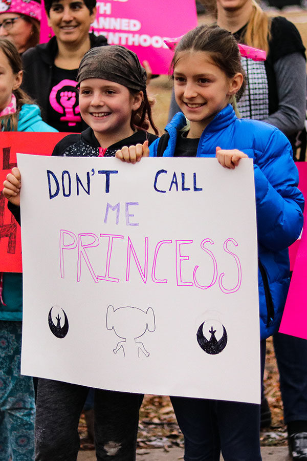 Young participants in the Women's March in Lawrence, Kansas pose for a picture with their sign Jan. 20.