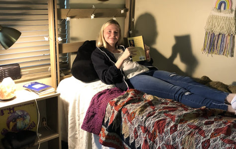 "Senior Anna Tomka reads ""Beloved"" by Toni Morrison while on a dorm room bed in Columbia, Missouri, as the farthest she went this Spring Break was The University of Missouri."