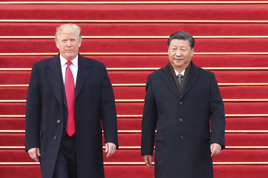 Chinese President Xi Jinping, right, holds a grand ceremony to welcome U.S. President Donald Trump at the square outside the east gate of the Great Hall of the People in Beijing, capital of China, Nov. 9, 2017.