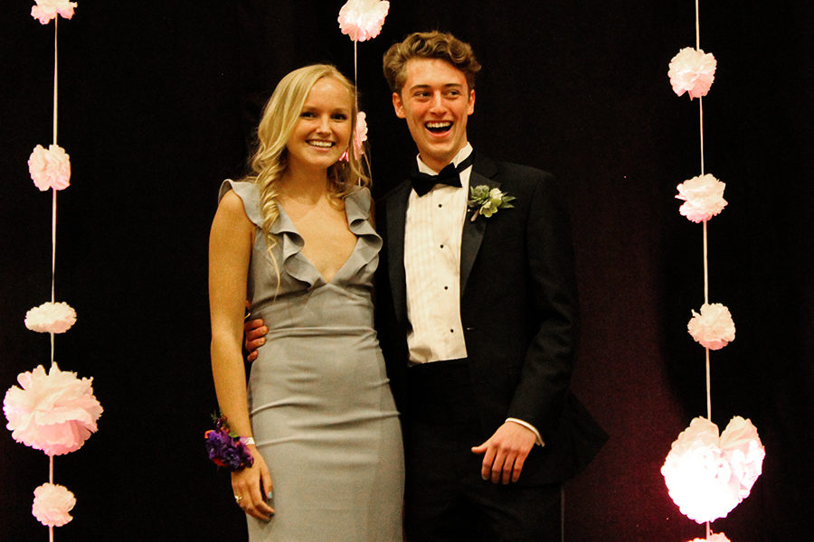 Senior+Catherine+Dehaemers+and+Rockhurst+High+School+Senior+Joe+Hathaway+stop+in+the+middle+of+the+stage+during+introductions%2C+which+took+place+before+the+Prom+queen+and+attendees+were+announced.