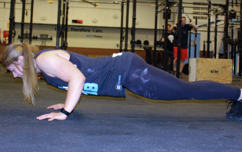 """During an after school gym session junior Isabelle does tricep pushups as part of her workout regimine.  """"It is different every time, sometimes I am working on some gymnastics skill and then I would do a strength session or weightlifting,"""" Ianni said."""