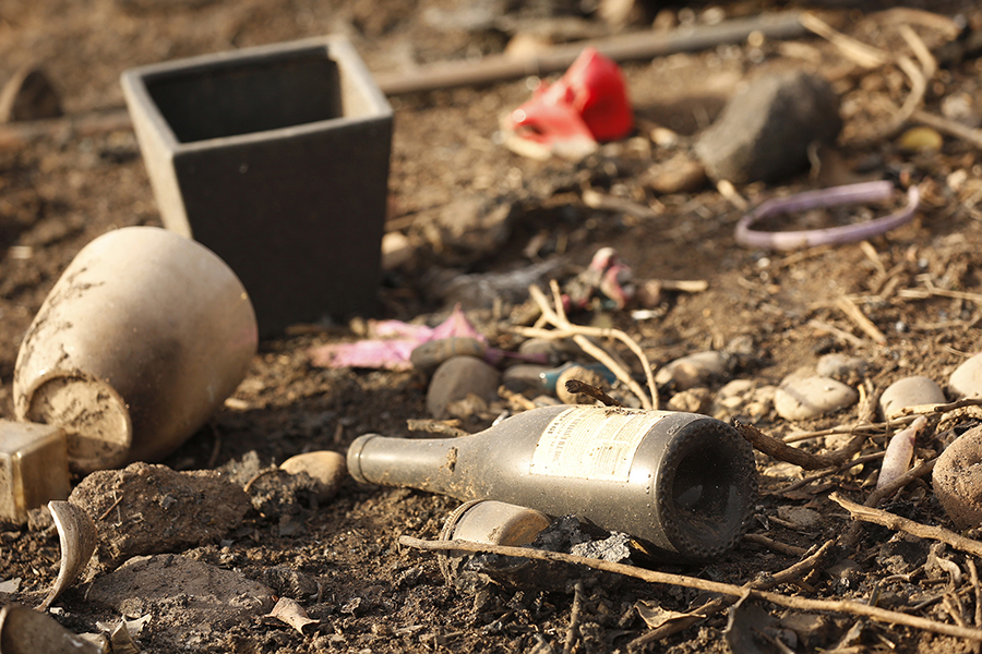 Charred debris litters the base of the Malibu hillside.