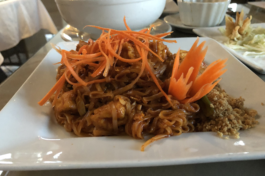 The pad thai entree which included carrots and crushed peanuts as toppings.