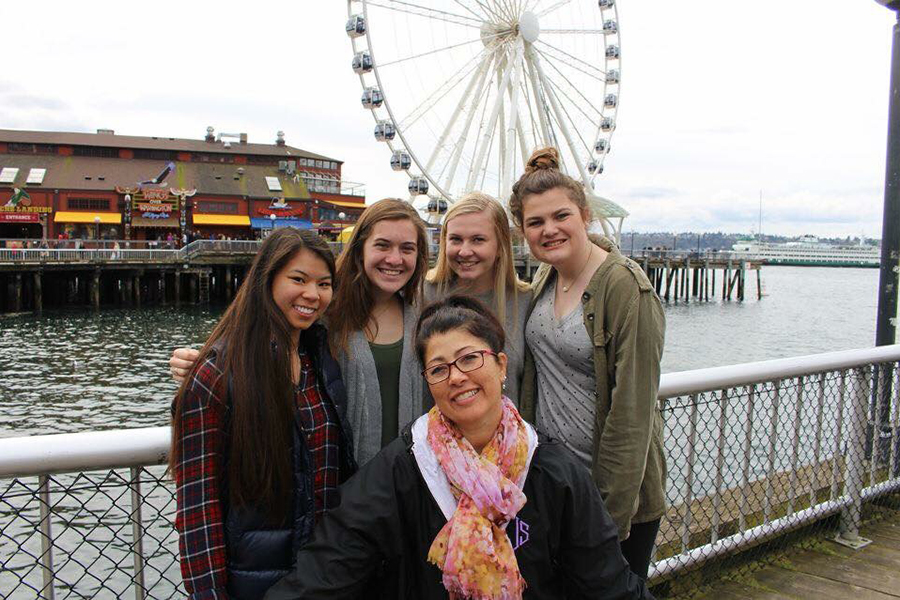 Seniors Courtney Hiatt, Lanie Jones, Anna Tomka, Kelly Nugent and journalism teacher Alison Long explore the pier in Seattle for the 2017 National High School Journalism Convention, the same weekend as Prom.