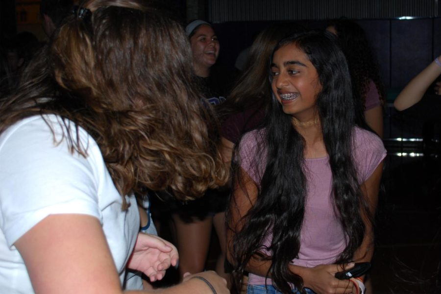 Sophomore Rajitha Velakaturi talks with friends at last years freshman mixer, Aug. 26, 2017. Freshman from Rockhurst and St. Teresa's are also invited to come.