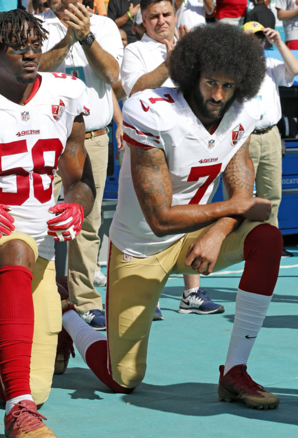Kaepernick+brought+on+nationwide+debate+when+he+took+a+knee+during+the+National+Anthem+to+protest+the+unlawful+killing+of+black+men+and+women+by+police+officers.