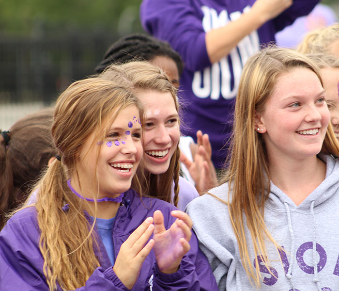Seniors+Julia+Hughes%2C+Audrey+O%E2%80%99Brien%2C+and+Delaney+Minor+cheer+as+math+teacher+Reynold+Middleton+gets+dunked+Sept.+21%2C+2018+at+the+Purple+White+field+day.