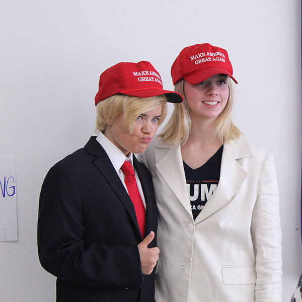 Dressed up as President Donald Trump and First Lady Melania Trump, seniors Liz Oltjen and Tori Beaver pose for picture during celebrity couples day Sept. 20.