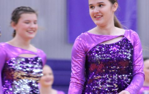 Senior Lily Muehlebach prepares to begin her performance with the dance team at the pep assembly, Sep. 6.