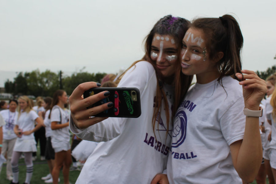 Juniors Reilly Jackoboice and Liz Jacobs take a victory selfie after the white team won the water balloon toss during field day.