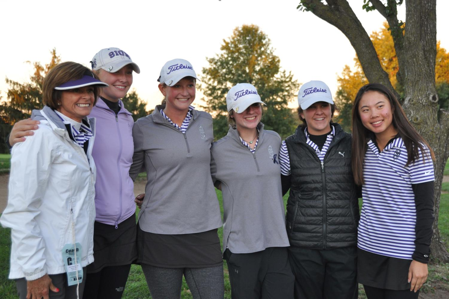 Golf coach Dana Hoeper, Junior Barbara King, Sophomores Megan Propeck, Lia Johnson, Caroline Giocondo and Junior Helen Willis get their picture taken after winning second place for the second year in a row at the Class 2 State championships at Swope Memorial Golf Course Oct. 16.