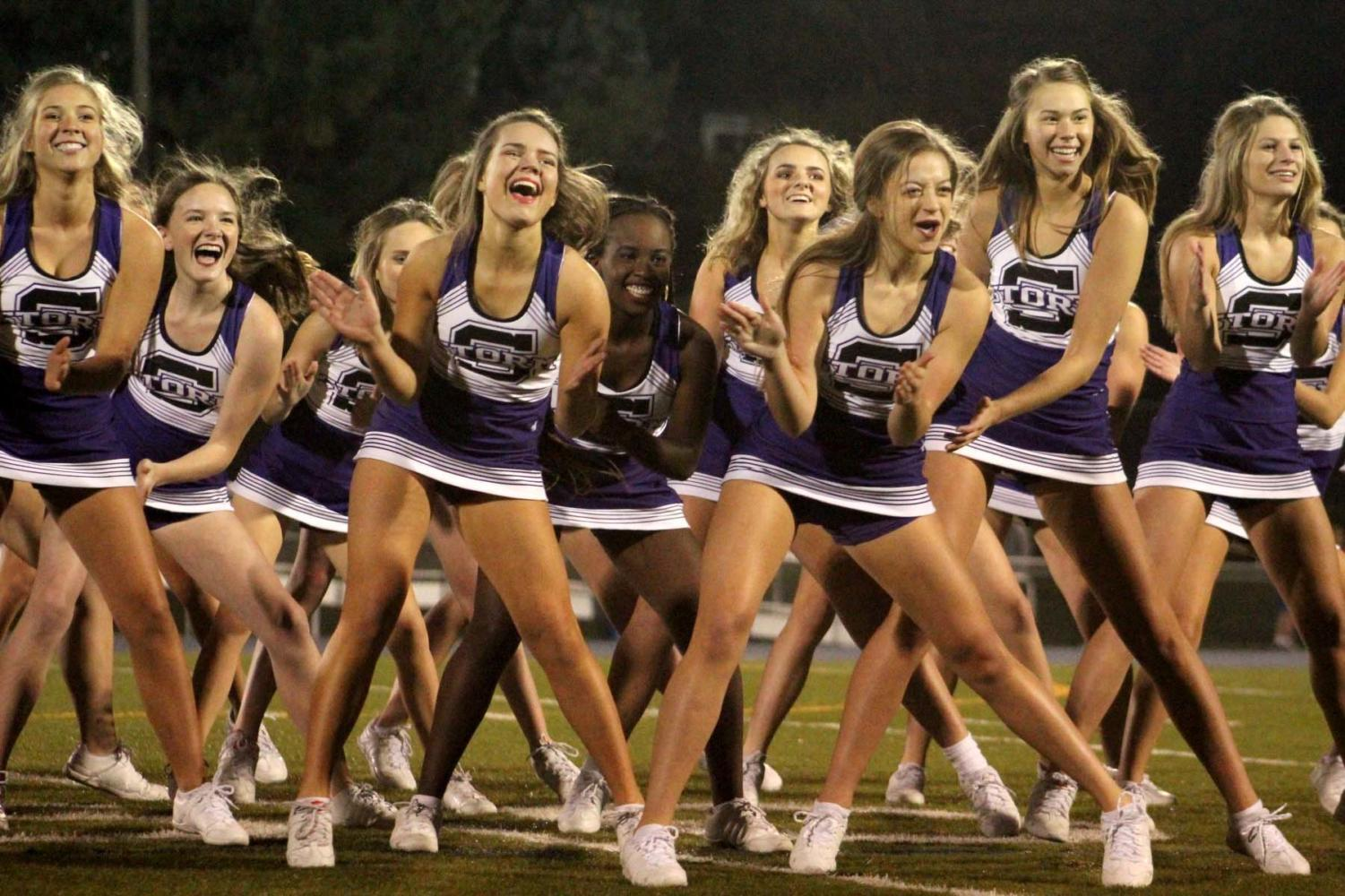 Seniors Mimi Wright, Liz Oltjen, Savannah Childress, and Lola Tebbe perform the dancing portion of the cheer routine performed at Rockhurst halftime Oct. 19. The routine was organized by the seniors, as is tradition.