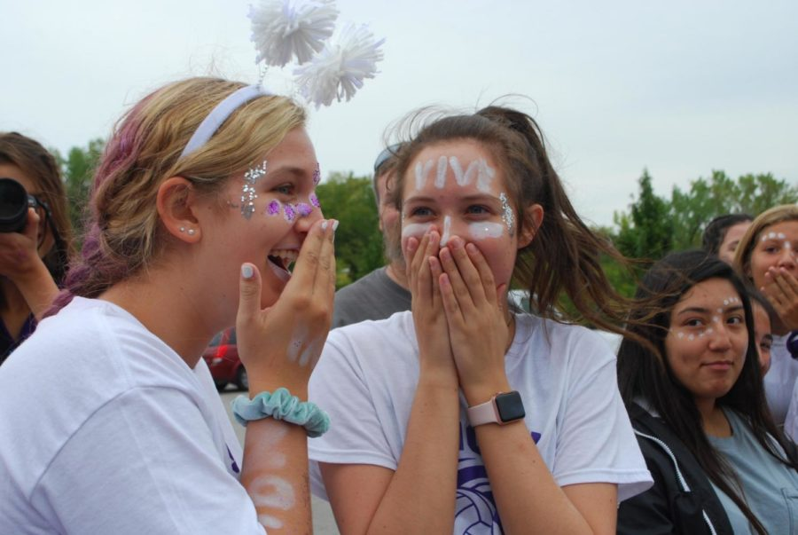 Sophomore Mikayla Gunther and junior Liz Jacobs react to junior Lily Henkle getting hit in the head by a softball thrown by sophomore Abby DeLong while she was aiming for the dunk tank at the Purple White field day Sept. 21.