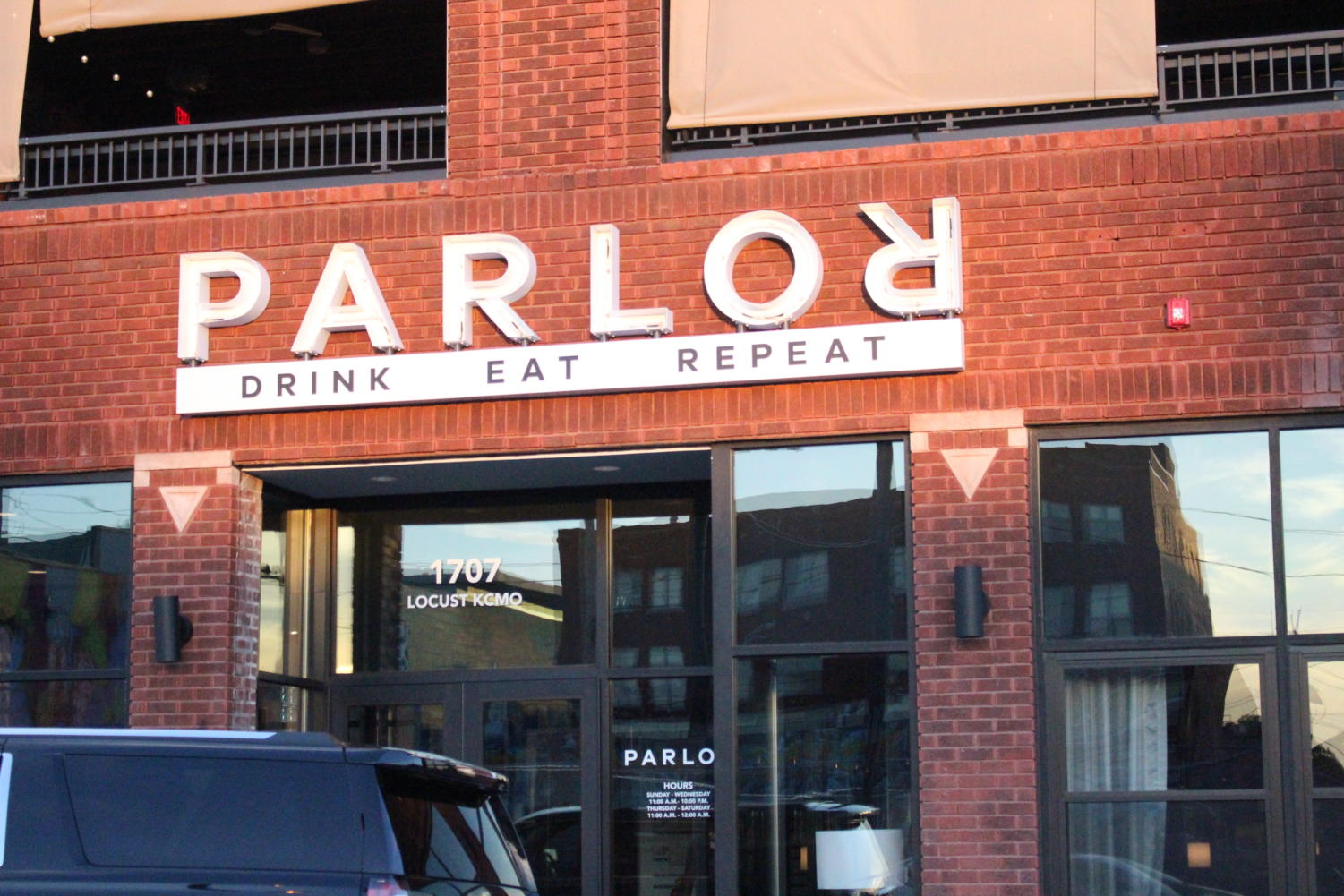 Parlor is located in The Crossroads and offers indoor and outdoor seating options.