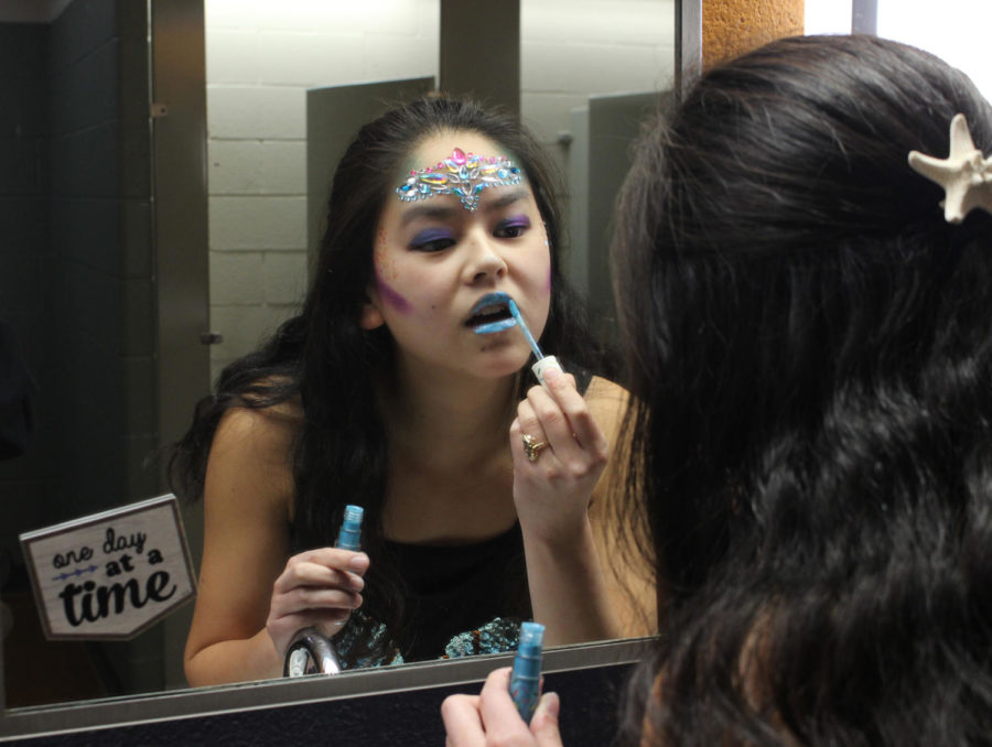Senior Sarah White touches up her mermaid makeup in between classes for Halloween, Oct. 31.