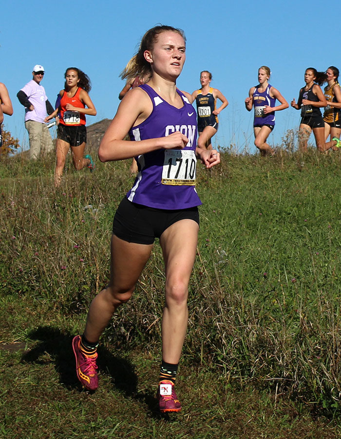 Junior Lily Henkle crosses the one mile mark during the Sectional cross country meet at the Wildflower Cross Country Course Oct. 27.