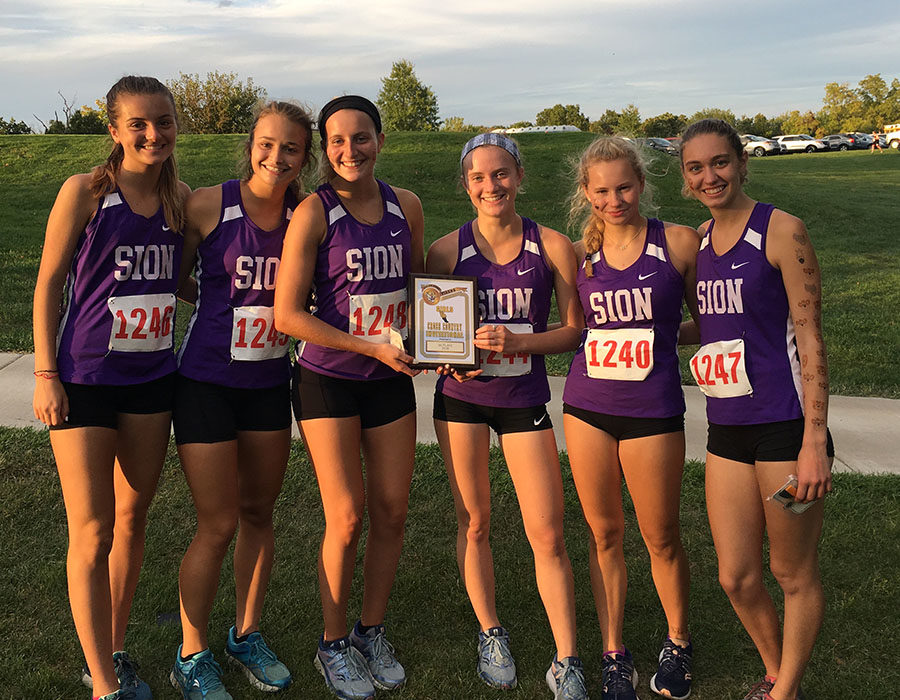 Juniors Rose Orrick and Nina Trouve, senior Gretta Allen, junior Lily Henkle, sophomore Dillan Elmquist and senior Brenna Richart proudly show off their first place plaque after winning the Excelsior Springs Invitational on Oct. 2.