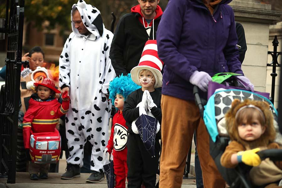 Children and their families wait in line to greet Minnesota Gov. Mark Dayton during Halloween festivities at the Governor's Mansion in St. Paul, Minn., on Tuesday, Oct. 31, 2017. Full-sized candy, apple cider and glow sticks were handed out. (Leila Navidi/Minneapolis Star Tribune/TNS)