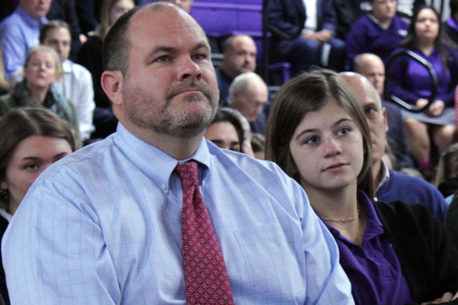 Sophomore Byrnna Dow and her dad Peter Dow sit together at the annual Father-Daughter Mass Nov. 1 in the gym. Father's were invited to attend the Mass that happens each year on All Saints Day.