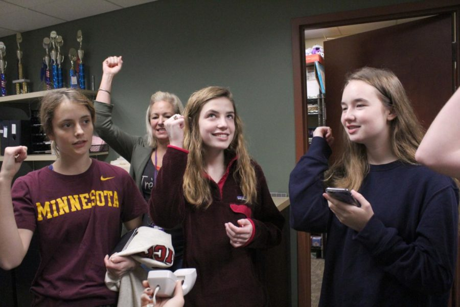 Juniors Phoebe Mullen, Rachel McRae, and Payton Wade sing the school song over the morning announcements Nov. 9.