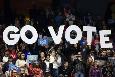 "Attendees hold up a ""Go Vote"" sign during a get-out-the-vote rally with former President Barack Obama, gubernatorial candidate J.B. Pritzker and other members of the Illinois Democratic ticket on Sunday, Nov. 4, 2018 at the UIC Pavilion in Chicago, Ill. (Armando L. Sanchez/Chicago Tribune/TNS)"