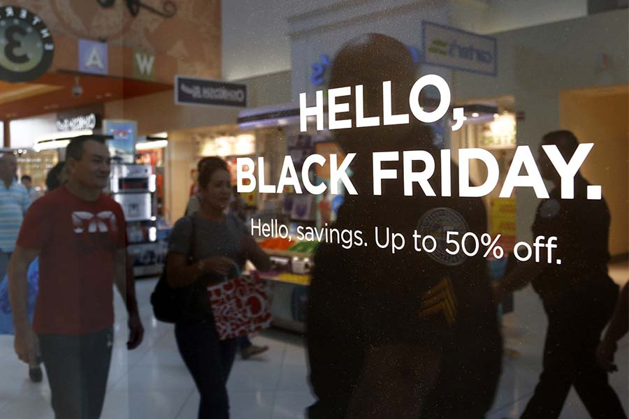 Stores advertise Black Friday sales to draw the attention of shoppers on Thanksgiving, Thursday, Nov. 24, 2016 at Dolphins Mall. Shoppers headed to the mall for their holiday shopping and savings.