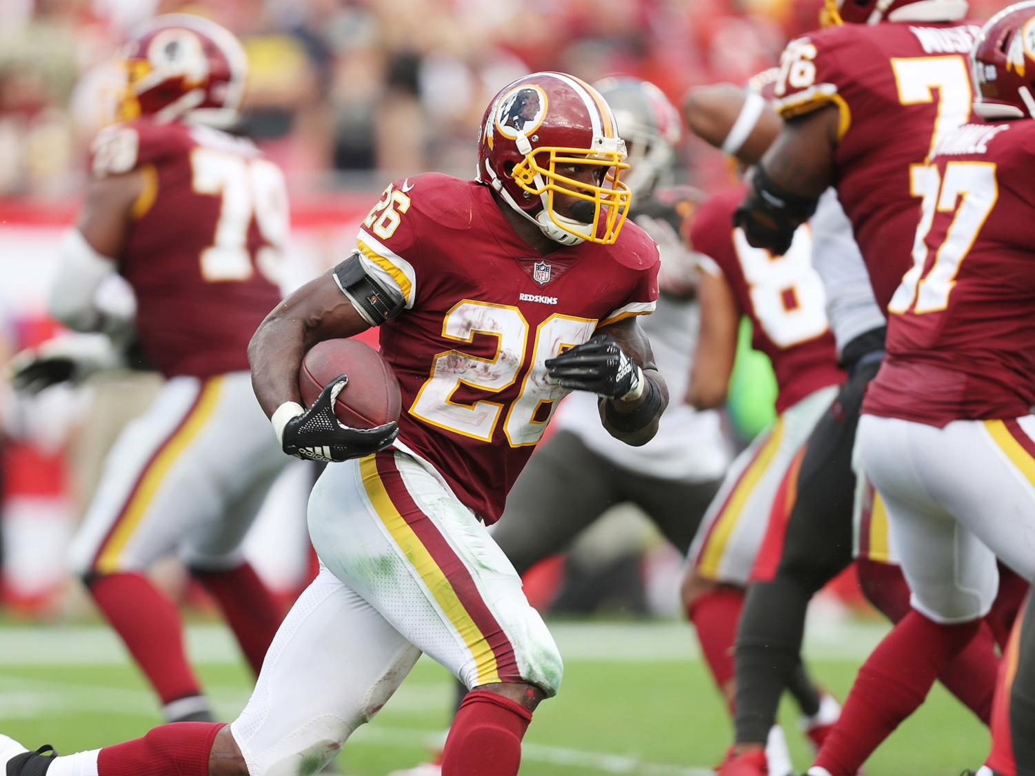 Washington Redskins running back Adrian Peterson (26) runs the ball for a first down against the Tampa Bay Buccaneers on November 11, 2018, at Raymond James Stadium in Tampa, Fla. (Monica Herndon/Tampa Bay Times/TNS)