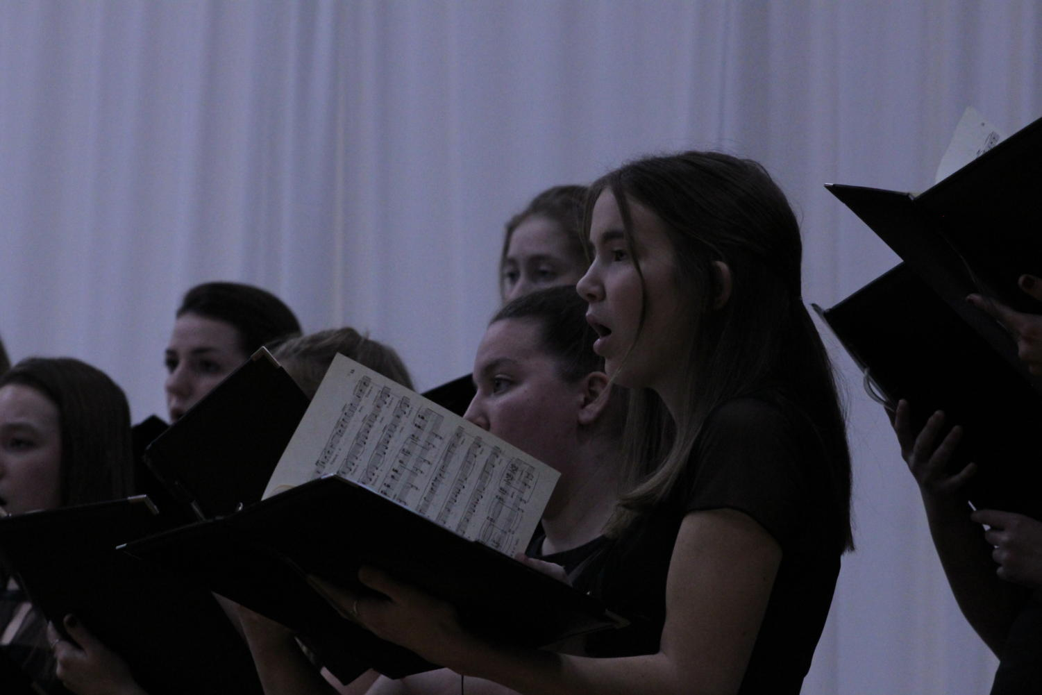 Junior Lilly Denney performs at the Christmas concert with Grand Choeur Dec. 11.