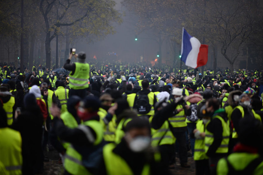 Yellow+vests+%28Gilets+jaunes%29+protest+against+rising+oil+prices+and+living+costs+on+the+Champs+Elysees+in+Paris%2C+France%2C+on+Dec.+1%2C+2018.+Thousands+of+anti-government+protesters+are+expected+today+on+the+Champs-Elysees+in+Paris%2C+a+week+after+a+violent+demonstration+on+the+famed+avenue+was+marked+by+burning+barricades+and+rampant+vandalism+that+President+Emmanuel+Macron+compared+to+%22war+scenes.%22+%28Eliot+Blondet%2FAbaca+Press%2FTNS%29