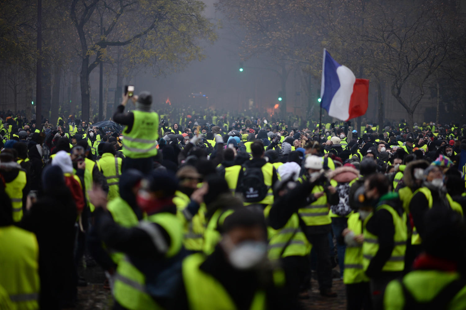 Yellow vests (Gilets jaunes) protest against rising oil prices and living costs on the Champs Elysees in Paris, France, on Dec. 1, 2018. Thousands of anti-government protesters are expected today on the Champs-Elysees in Paris, a week after a violent demonstration on the famed avenue was marked by burning barricades and rampant vandalism that President Emmanuel Macron compared to